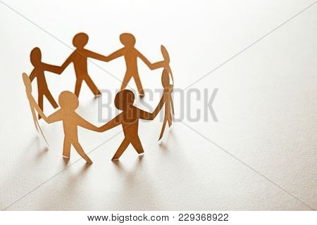 Paper people on light background. Unity concept