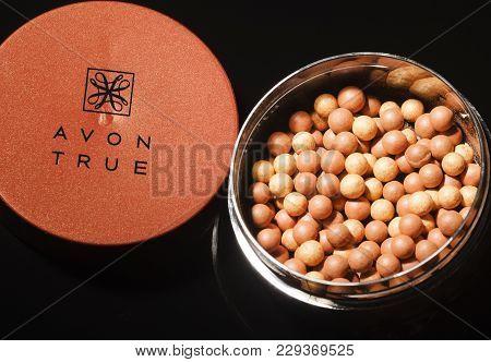 Kwidzyn, Poland - March 1, 2018: Avon Glow Bronzing Pearls Isolated On Dark Background. Avon Product