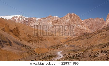 Bike Trip Through Curly Road Along The River On Himalaya Highlands. Scenic View On Landscape With Go