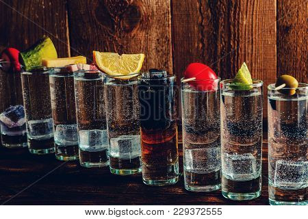 Shots With Alcohol On A Wooden Table. Inside The Ice Cubes. On Each Shot, On Top Of That Lies - Radi