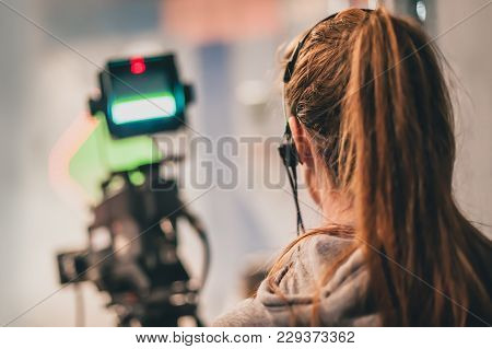 Behind The Scene. Female Cameraman Shooting Film Scene With Camera