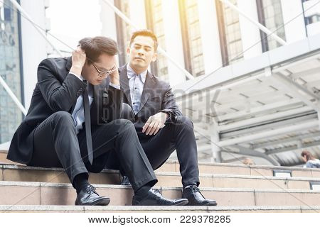 Desperate And Unemployed People, Economic Downturn Concept, Frustrated Businessman Sitting On Stair,