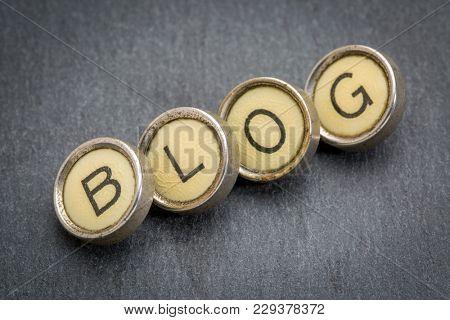 blog word spelt in vintage typewriter keys against gray slate stone