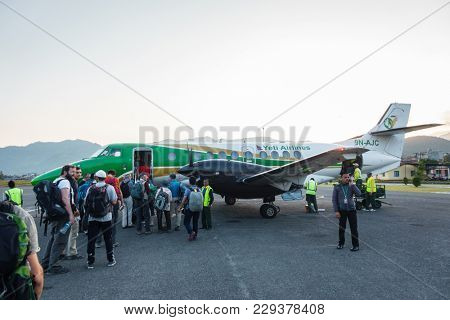 POKHARA, NEPAL - CIRCA NOVEMBER 2017: Passengers board a Yeti Airlines flight to Kathmandu.