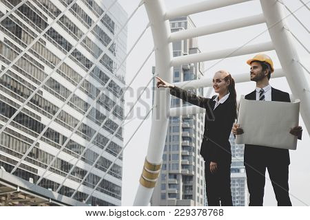 Businesswoman Pointing  And Engineering Planning At Construction Area On Bridge For Renovation And M