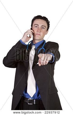 Young Doctor Talking On A Cell Phone And Pointing