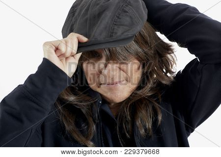 Attractive Woman With Brown Hair Putting On A Derby Cap