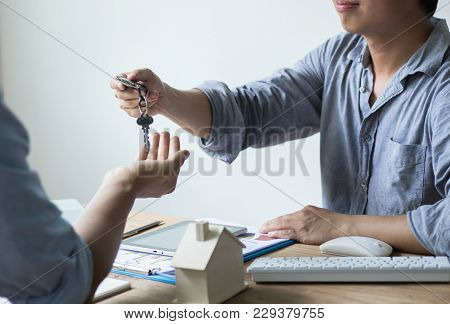 House Key Given By Salesman, Concept In  Insurance Broker Agent's Hand Protection, Businessman Givin
