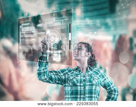 Woman Using High Tech Screen On A Abstract Background With Bkeh Lights.