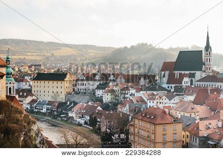 View Of The St. Vitus Church, Houses And River In Cesky Krumlov In The Czech Republic. The Church Is