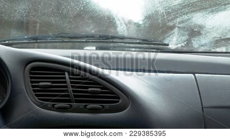 Closeup View Air Vent Nozzle On Car Dashboard While Driving.
