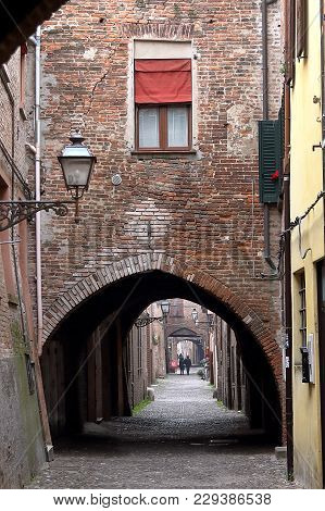 Ferrara, Italy - January 7, 2018: The Picturesque Arched Alley Via Delle Volte, Ancient Medieval Str