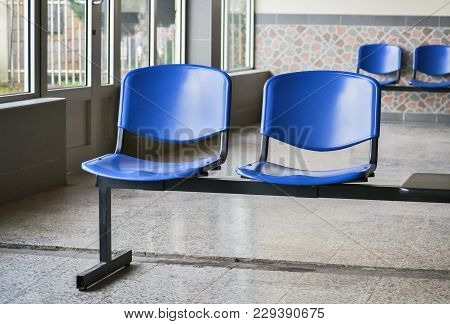 Detail Of A Public Waiting Room With Several Plastic Chairs