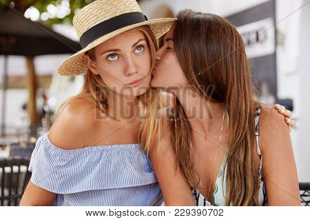 Portrait Of Fashionable Young Females Lesbians Have Passionate Kiss, Have Good Relationships, Demons
