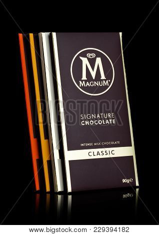 London, Uk - March 01, 2018: Luxury Chocolate Bars Of Magnum Signature Dark Chocolate On Black Backg