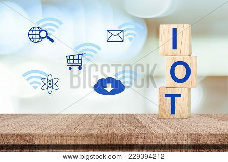Internet Of Things Concept, Iot On Wooden Cubes And Inter Net Of Thing Icon Over Blur Background, Te