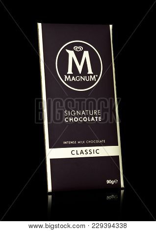 London, Uk - March 01, 2018: Luxury Chocolate Bar Of Magnum Signature Dark Chocolate On Black Backgr