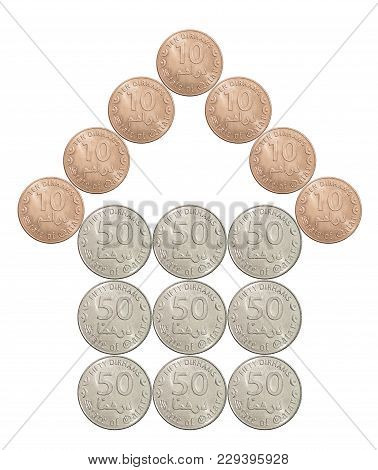 House Built From Qatar Dirham Coins Isolated On White Background
