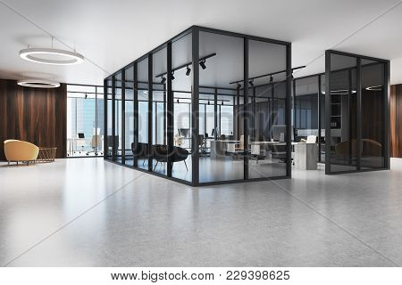 Open Space Office Corridor With A Dark Glass Open Space Environment And A Yellow Armchair In The Wai