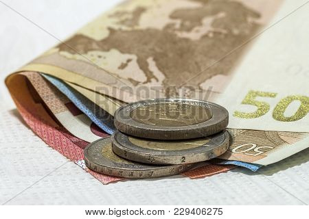 Money Euro Coins And Banknotes Stacked On Each Other In Different Positions. Money Concept. Detail O