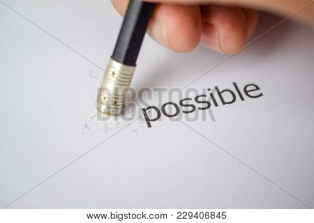 Changing The Word Impossible To Possible With A Pencil Eraser - Business Concept