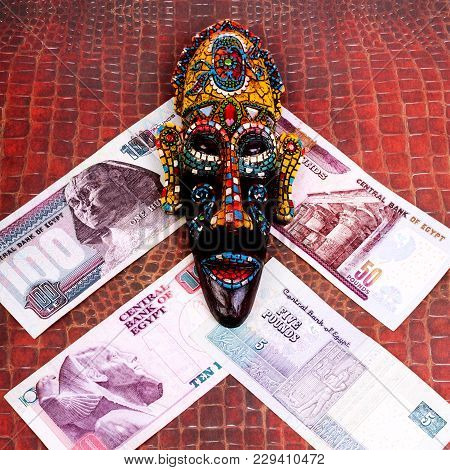 The Egyptian Souvenir Mask And The Egyptian Money, On A Red Background Of Crocodile Skin. Square. Cl