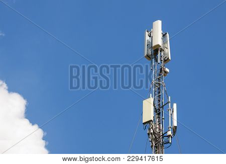 Communication Antenna Tower With Blue Sky,telecoms Technology. Mobile Phone Base Station