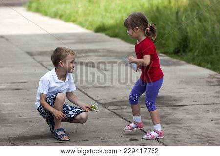 Young Boy And Girl Brother And Sister Together Laughing Happily Play Outside