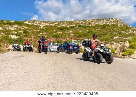 Zakynthos, Greece - October 1, 2017: Young People Driving Quads On Road. Quad Is Very Popular Means