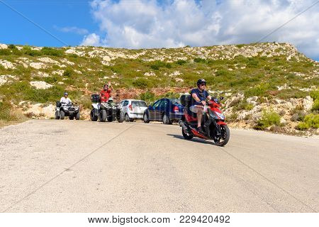 Zakynthos, Greece - October 1, 2017: Young People Driving Scooter And Quads On Road. Quad Is Very Po