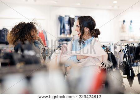 Two Young Beautiful Attractive Girlfriends Go Shopping