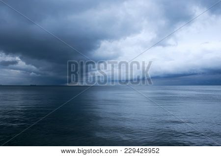 Dramatic Storm Clouds Over The Sea. Baltic Sea. Seascape In Front Of A Storm. Marine Background