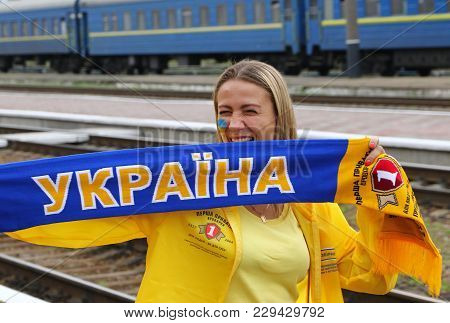 Kharkiv, Ukraine - September 2, 2017: Girl Poses With A Scarf During Fan-march Of Ukrainian National