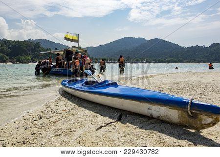 Pangkor Island, Malaysia - 17 December 2017 : Tourist Enjoying Island Hoping Beach Activities At Pan