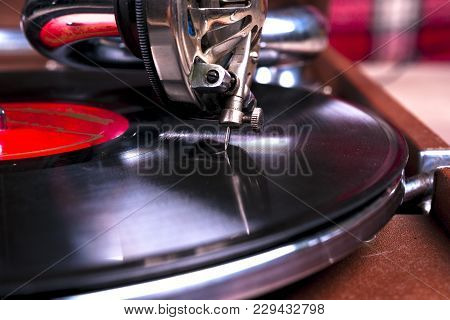 Old Gramophone Player, Closeup. Retro Styled Image Of A Collection Of Old Vinyl Record Lp's With Sle