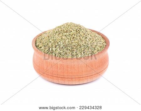 Dried Rosemary In Wooden Bowl For Spices Isolated On White Background. Crushed Rosemary. Closeup.