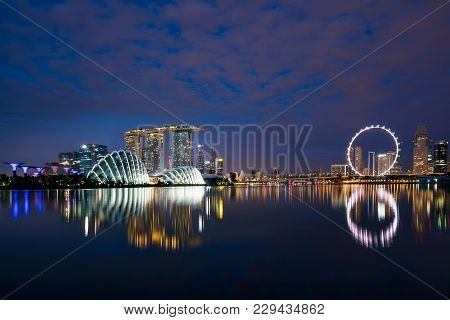 Singapore Business District Skyline In Night At Marina Bay, Singapore. Asia