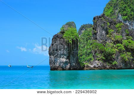 Crystal Clear Water Hong Bay, Kra Bi Andaman Sea Of Thailand Against Beautiful Clear Blue Sky.