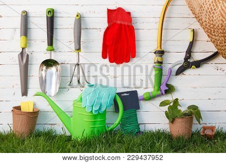 Gardening Tools And Utensils On Green Meadow, Garden Manteinance And Hobby Concept.
