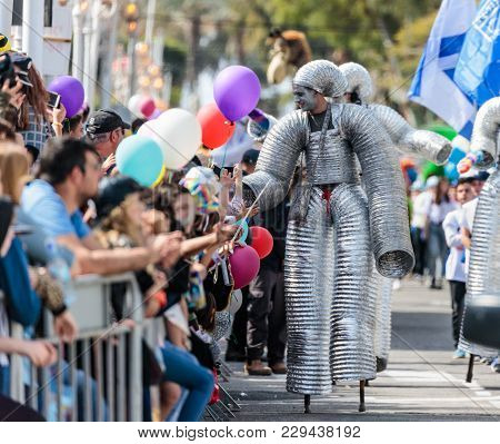 Nahariyya, Israel, March 02, 2018 : Participants Of The Annual Carnival Of Adloyada Walking On Stilt