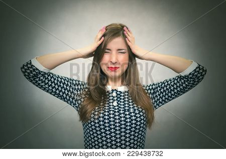 Overworked Woman In Stress Is Holding Her Head By Her Hands And Try To Solve Her Problem Isolated On