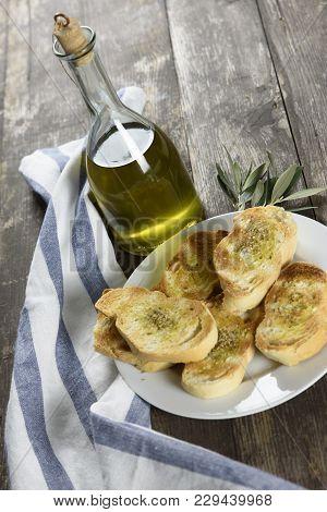Italian Oil In The Bottle With Roast Bread, Bruschetta