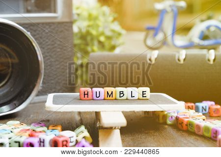 Conceptual Image With Humble Word Block On Wooden Signage Over Soft Focus Background