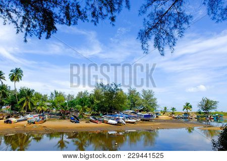 Beautiful Traditional Fisherman Village Located At Terengganu, Malaysia At Sunny Day With Blue Sky B
