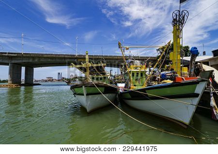 Fisherman Boat Located At Terengganu, Malaysia At Sunny Day With Blue Sky Background.