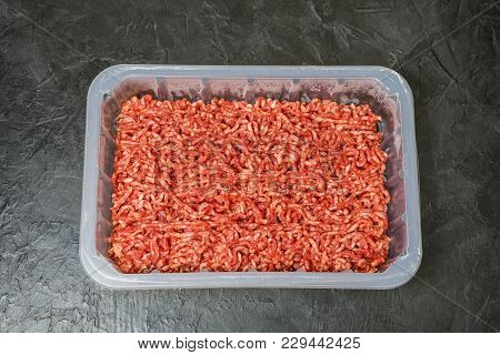 Minced Meat On A Black Background. Place For Your Text...