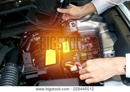 Asia Man With Engine On Blurry Background.for Automotive Or Maintenance, Service Or Transport Image.