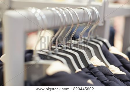 Fashionable Clothes On Hangers In Modern Shopping Mall. Clothes Store For Women And Men. Items Of Cl