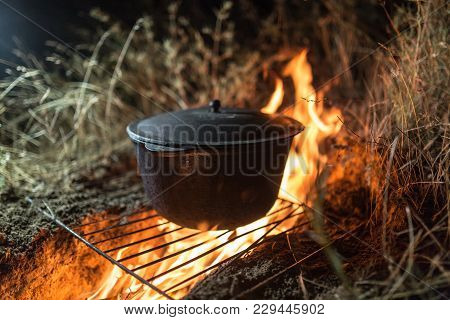Cauldron On Fire At Night . In The Park In Nature
