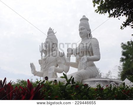 Side View Of Lord Shiva & Parvati Statue .